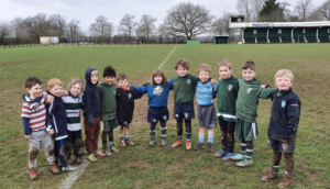 A dozen didi rugby stars in a group at Reading RFC