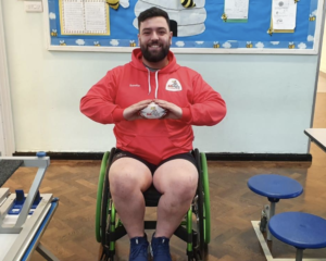 didi rugby coach Umit Akyildiz is in his wheelchair holding a didi rugby ball