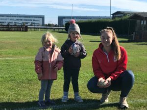 didi rugby Reading coach and keen rugby player Caitlin Clark smiles next to two happy children