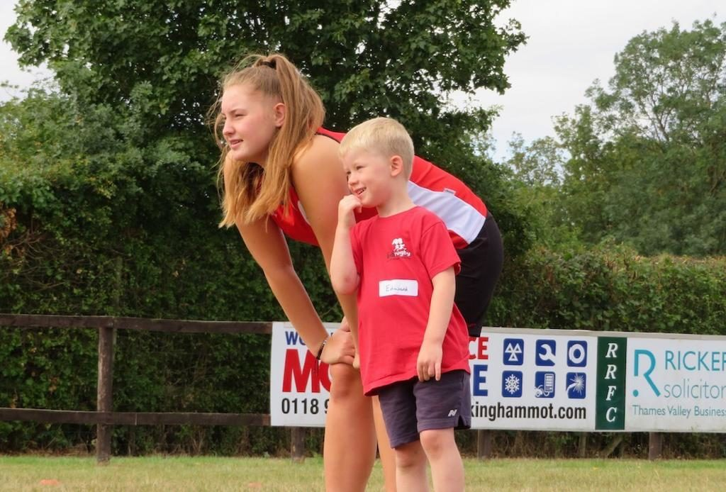 didi rugby coach Caitlin Clark with a young boy at a class
