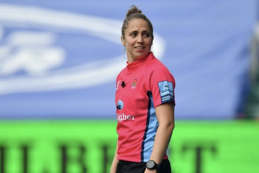 didi rugby ambassador Referee Sara Cox looks to one side and smiles