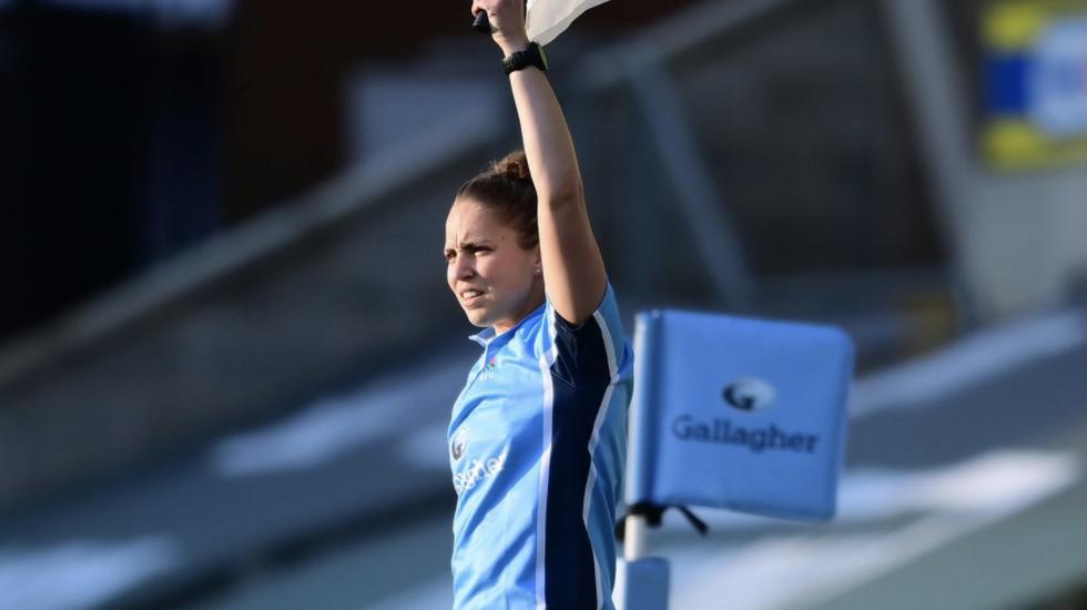 didi rugby ambassador Sara Cox raises a flag