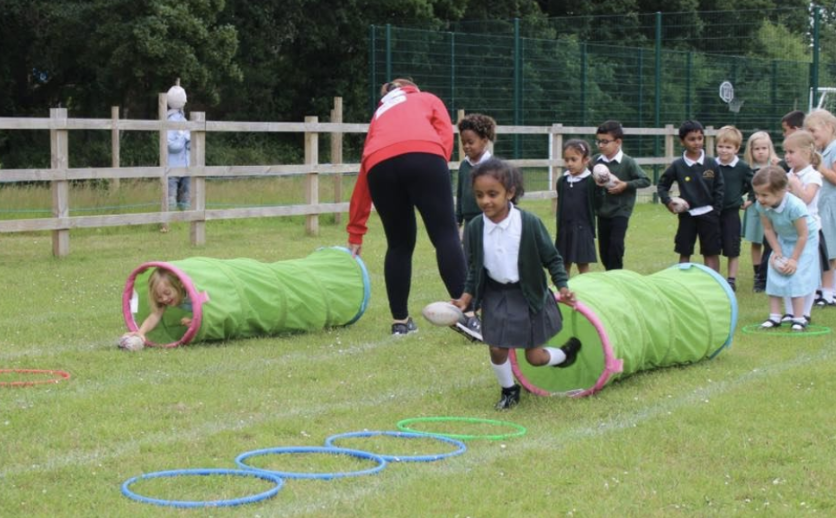 Children complete a didi rugby session at school