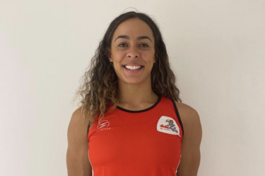 England player Deborah Fleming wearing a didi rugby red vest